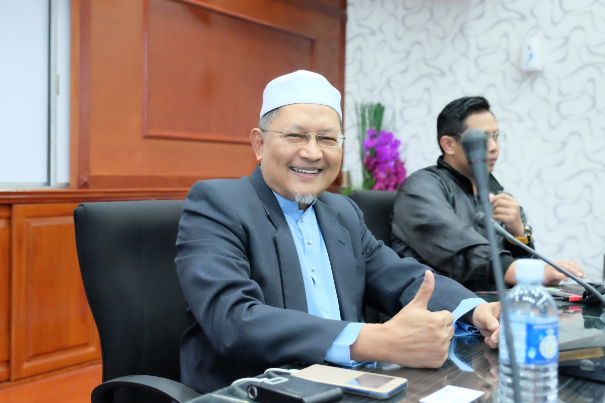 chairman of the guides of the Mosque, HJ Tanzil MD Noor.jpg