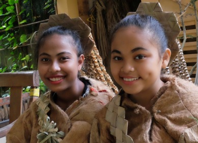 A close-up view of two Mah Meri girls
