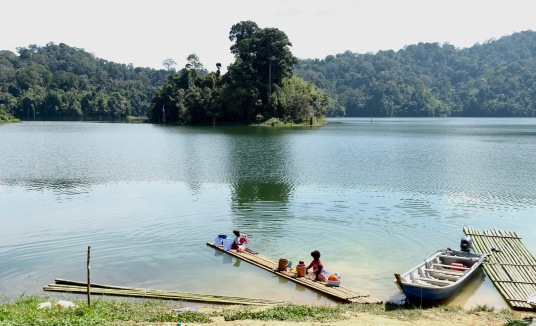 Orang Asli villagers washing clothes in lake