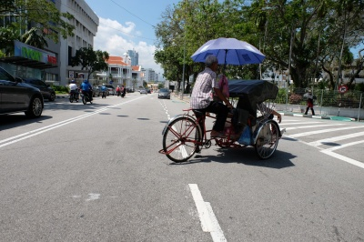 "A Trishaw ride in the streets of George Town - ""Kings of the road"", these vehicles have right of way at all times!"