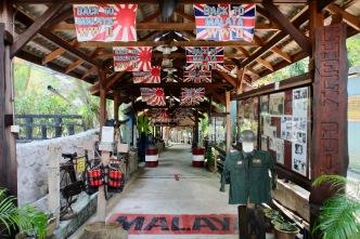 Penang War Museum entrance area with kamakaze harness and legendary Japanese bike
