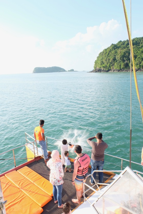Jumping in and cooling off during Seasation Sunset Cruise in Langkawi