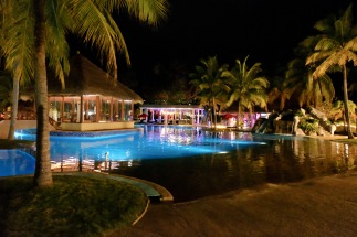 Night time pool scene at Sand & Sandals Resort