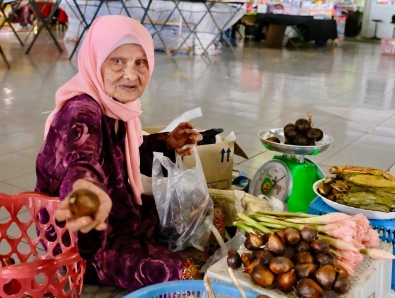 Kota Bharu Market Scene - elderly woman selling produce