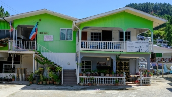 One of the gaily coloured local homes that make-up Ranau Walai Tokou Homestay