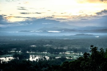 View from hilltop lookout at Rasa Ria Resort towards mountains at sunrise